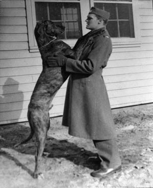 With his Great Dane, Lancelot, ROTC Cadet John Hanlon poses in 1939, during his days on the campus of the University of New Hampshire.