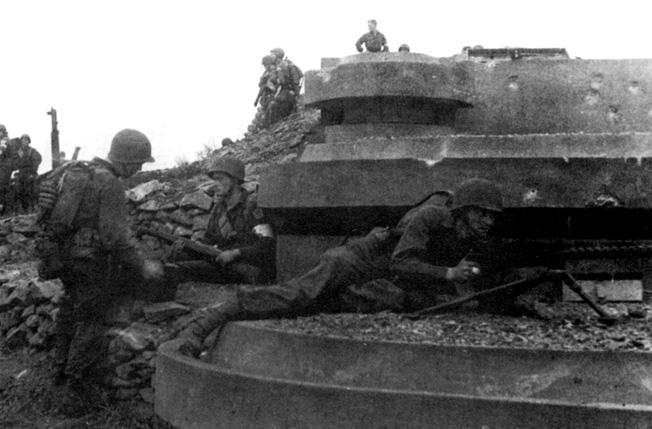 Men of the 1st U.S. Ranger Battalion guard a captured gun position after heavy fighting in Arzew, Algeria.