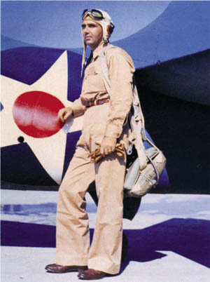 Butch O'Hare poses beside his F4F-3 Wildcat, spring 1943. He is wearing a leather cowboy belt instead of the standard-issue web belt.