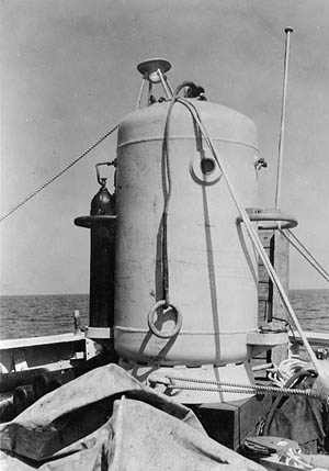A diving bell rests on the deck of the USS Falcon as the effort to raise the USS Squalus gets underway.