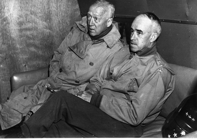 On an inspection flight along the Western Front on September 9, 1944, General George S. Patton, Jr. (left) and General Omar Bradley reveal their strain and fatigue during the campaign to liberate Western Europe from the Nazis.