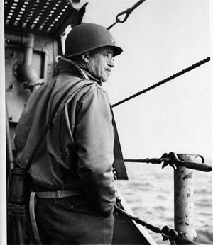 During the difficult early hours of D-Day, General Bradley gazes toward the coast of France. The situation on Omaha Beach was in doubt to such an extent that Bradley considered withdrawing those ashore and diverting later waves to Utah Beach.