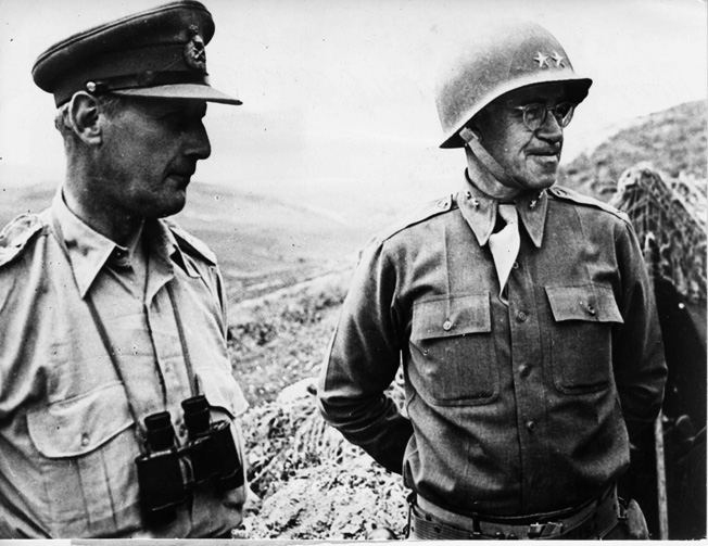 During the fighting in North Africa, General Omar Bradley (right) confers with Lieutenant General Kenneth Andersen, commander of the British First Army, as they inspect positions in Tunisia.
