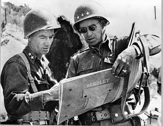 Near the town of South Caterina, Sicily, General Omar Bradley (right) confers with Major General Terry Allen, commander of the U.S. 1st Infantry Division. In Sicily, Bradley served as a corps commander in General George Patton's Seventh Army.