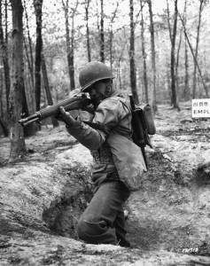A U.S. soldier aims his M-1 Garand during training exercises.