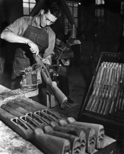 In September 1940, a worker finishes the wooden gunstock of an M-1 Garand rifle. Thousands of M-1s were produced at several sites in the U.S. during World War II