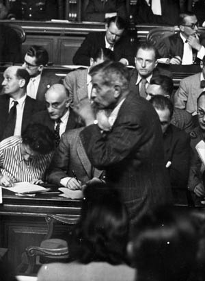 On March 8, 1945, French Fascist Pierre Laval testifies during the trial of Marshal Pétain for treason.