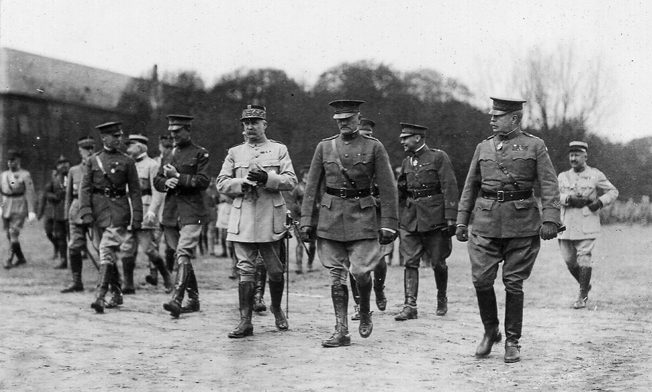 Following a ceremony on April 29, 1919, during which a number of French and American officers received decorations, Marshal Philippe Pétain of France and American General John J. Pershing walk from the assembly area near Metz.