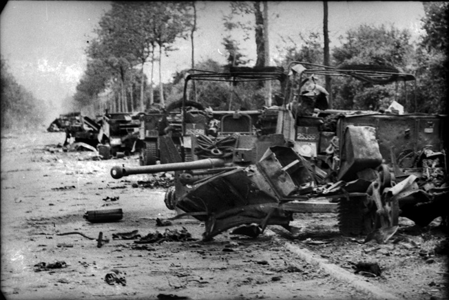 Destroyed vehicles of the British 7th Armored Division litter the road in the French town of Villers-Bocage. Michael Wittmann singlehandedly smashed a British armored spearhead with his lone Tiger tank on June 13, 1944.