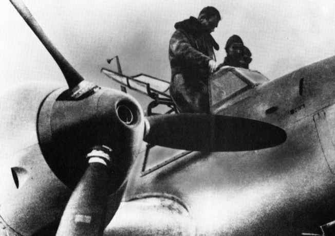 Prior to taking off for a practice flight, Rudolf Hess stands in the cockpit of the Me-110 twin engine fighter he later flew to England during an abortive peace mission.