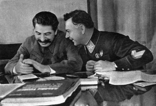 Soviet Premier Josef Stalin and Marshal Kliment Voroshilov share a lighter moment during a conversation.