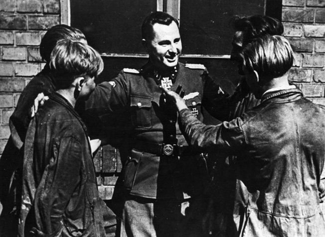 During a visit to Berlin on July 7, 1944, Leon Degrelle talks with Belgian volunteer workers who have relocated to the German capital.
