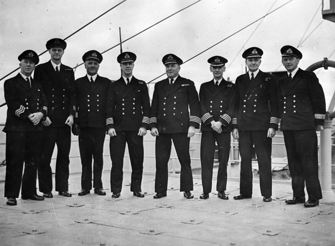 The officers of the Queen Mary pose for a photograph in November 1944. Standing fourth from the right is Captain James C. Bisset.
