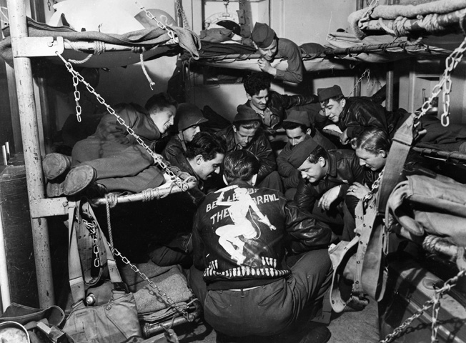 The crews of numerous U.S. Army Air Corps heavy bombers occupy a first-class cabin aboard the Queen Mary in November 1944. During the war, 12 bunks occupied the space normally allotted to one bed aboard the great ship.
