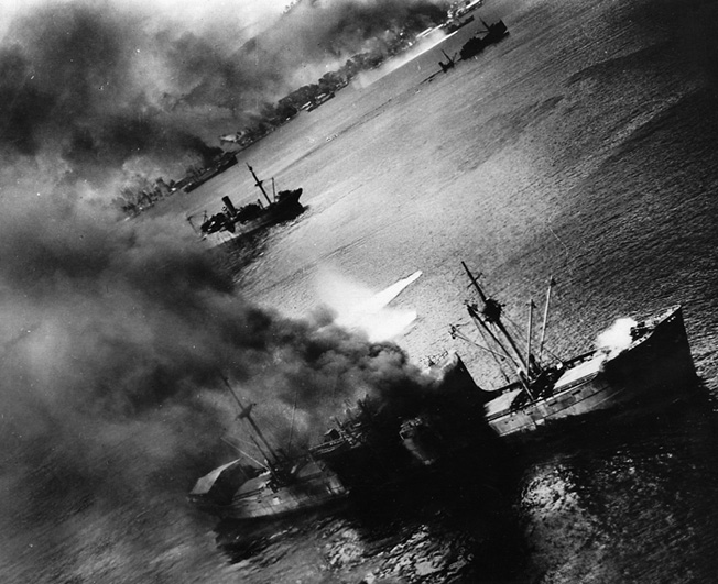 Japanese transport ships in the harbor at Rabaul suffer hits and near misses from U.S. bombers.