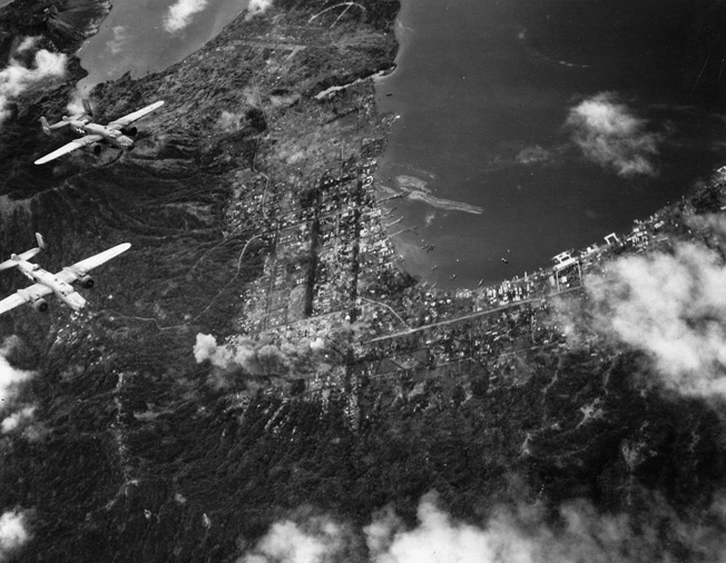 U.S. B-25 Mitchell bombers of the 13th Air Force wing their way above the Japanese bastion at Rabaul in March 1944. The major Japanese supply base and staging area was repeatedly bombed during the American offensive in the South Pacific.