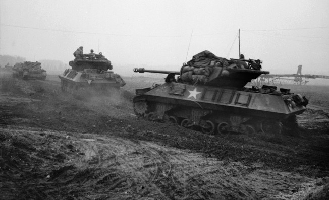 During the opening hours of Operation Veritable, Achilles tank destroyers of the 15th Scottish Division advance toward the Reichswald on February 8, 1945. The main armament of the Achilles was a 17-pounder gun mounted in an open turret.