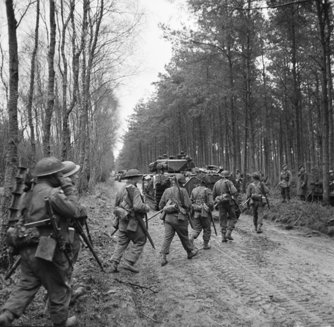 On February 10, 1945, British troops of the 2nd Seaforth Highlanders advance into the Reichs- wald during operations intended to breach German defensive positions and reach the Ruhr, the industrial heart of Germany. Bitter German resistance upset the British timetable and delayed the advance envisioned by British Field Marshal Bernard Montgomery.