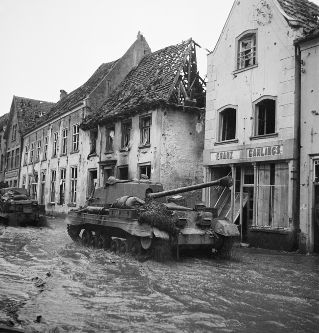 Photographed in the flooded streets of the German town of Kranenburg on February 11, 1945, these British Archer tank destroyers are attempting to reach the front. German defenders opened the gates of numerous dams and flooded extensive areas to slow British progress during Operation Veritable.