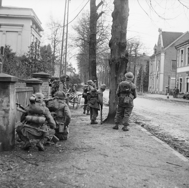 Clearing German snipers and rearguard positions was hazardous duty for these men of the British 2nd Gordon Highlanders advancing through Cleve on February 11, 1945.