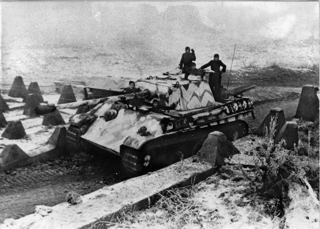 Moving into position along the German frontier, this PzKpfw. V Panther tank was photographed several weeks prior to the initiation of Operation Veritable.