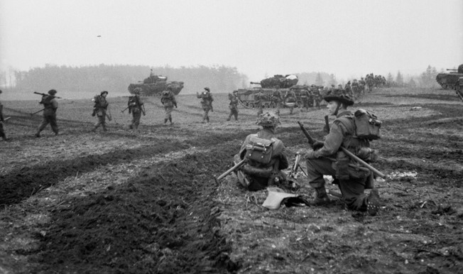 British Churchill tanks support the advance of infantrymen of the 2nd Argyll and Sutherland Highlanders on February 8, 1945. The British advance into the Reichswald was agonizingly slow, and casualties were heavy as the effort to reach the Ruhr bogged down against heavy German resistance.