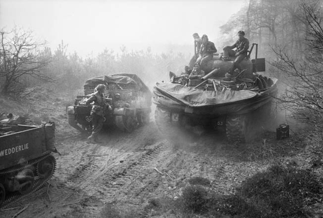 After crossing the Rhine, a Sherman Duplex Drive amphibious tank (right) provides a lift to men of the 6th Kings Own Scottish Borderers, 15th Scottish Division, moving to link up with the 507th PIR.
