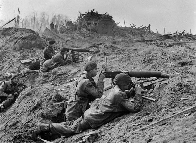 Men of the 1st Commando Brigade fire a pair of British Vickers machine guns against German positions on the outskirts of Wesel.