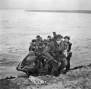 Exiting their flimsy storm boats, these soldiers of the 15th Scottish Division have just completed a successful crossing of the Rhine on the morning of March 24, 1945. The storm boats were less than popular with the troops, particularly in swift moving waterways.