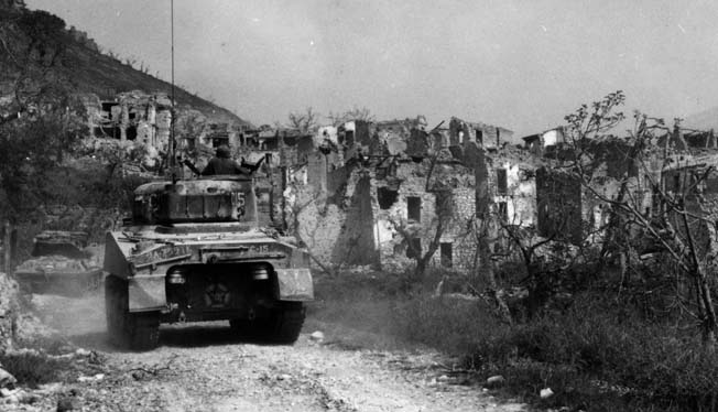 Allied tanks move through the ruins of the town of Castelforte, Italy, on February 13, 1944, two days after Operation Diadem began.