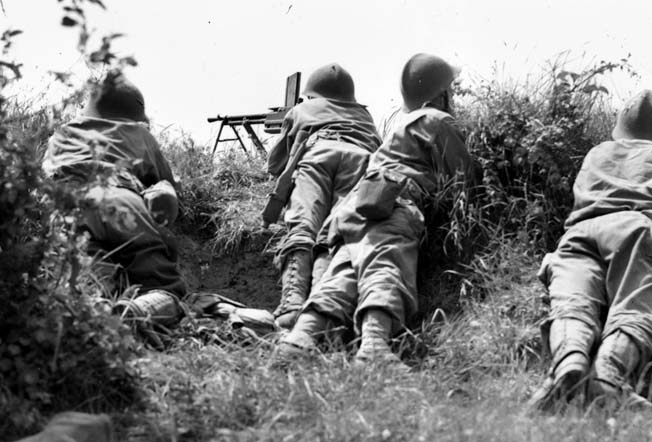 Algerian soldiers of the French Expeditionary Force played a critical role in the drive that led to the fall of Rome. Here a squad fires its Model 1924 M29 light machine gun against German positions at Castelnuovo on May 16, 1944.