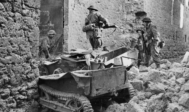 An abandoned German weapons carrier lies smashed along a roadside as soldiers of the British Eighth Army search for German snipers in Acquino on May 27, 1944.