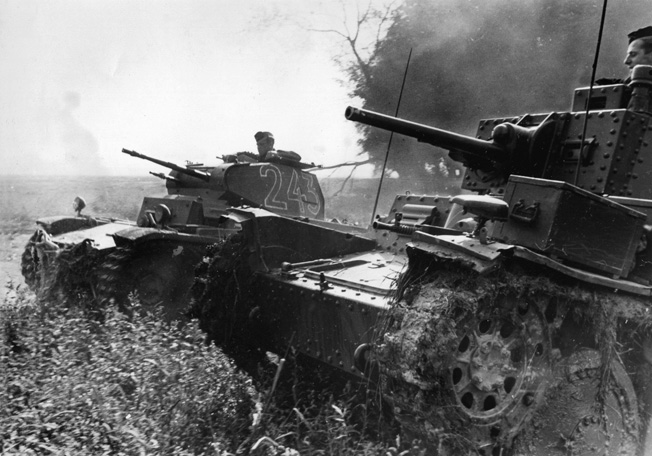 Two German Panzer 38(t) tanks of the 7th Panzer Division push through a small creek on the way into the heart of France.