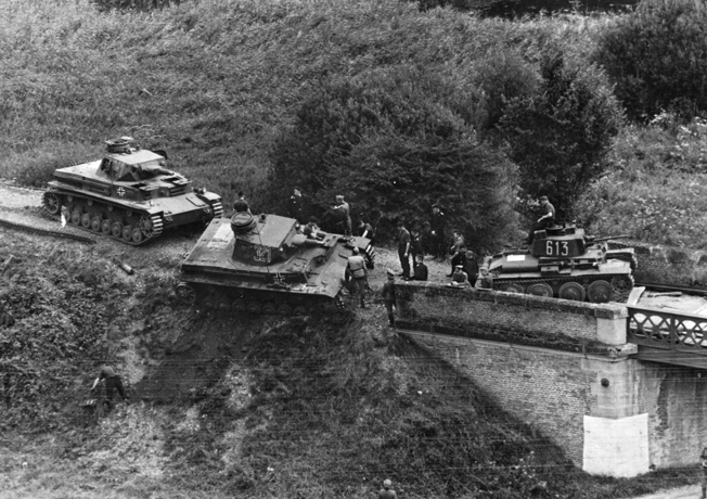 The river crossing stalled when a Panzer IV blocked the way over a railway bridge.