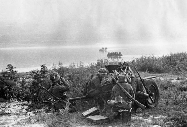 In preparation to support the crossing of a Russian stream during the advance on Rostov, the crew of a German antitank gun sets up a defensive position.