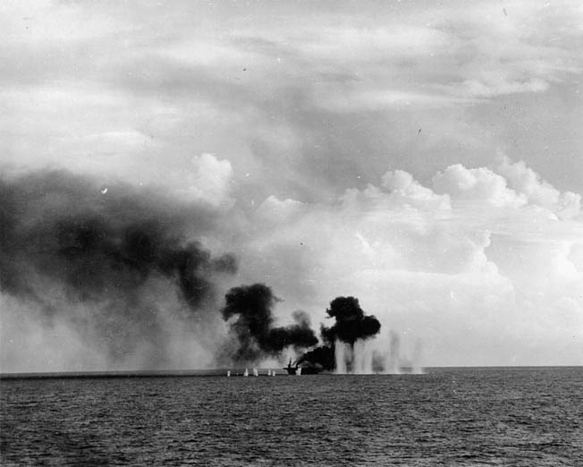 Heavy-caliber shells from Japanese ships bracket the escort carrier USS Gambier Bay during the battle off Samar. Already hit and on fire, the little escort carrier eventually rolled over and sank. The escort carriers were so thinly armored that some Japanese shells passed through one side of their hulls and out the other without detonating.