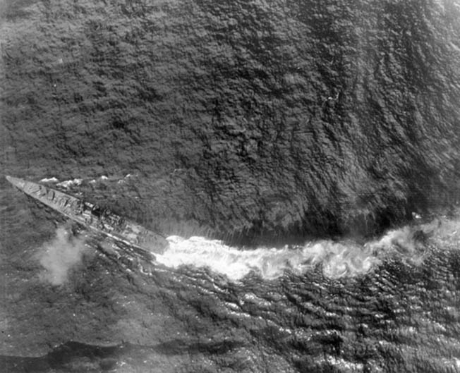 After sustaining torpedo damage during the battle off Samar on October 25, 1944, the Japanese cruiser Chikuma maneuvers violently to avoid more damage. The aggressive attacks of the American destroyers and destroyer escorts helped convince the Japanese that they were facing a much more powerful force.