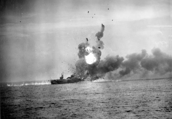 The escort carrier USS St. Lo was struck by a Japanese kamikaze suicide plane on the same day of the battle off Samar. The small carrier was wracked by explosions and later sank.
