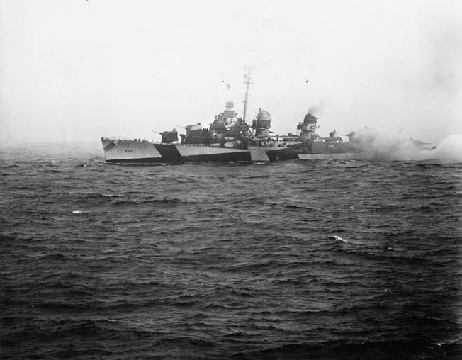 The destroyer USS Heermann brews up a smokescreen off Samar and fights to defend the escort carriers of Taffy 3. Heermann was one of several destroyers and destroyer escorts that crews sailed into an unequal fight with heavy Japanese ships. Heermann survived the ordeal.