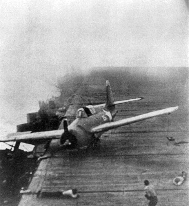 Making an emergency landing while the Enterprise is under attack by planes from the Japanese carrier Junyo, this Grumman F4F Wildcat skids across the flight deck.