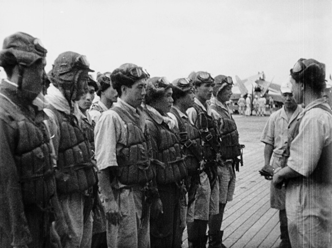 Veteran pilots of the Imperial Japanese Navy receive last minute instructions prior to takeoff from the decks of their aircraft carriers.