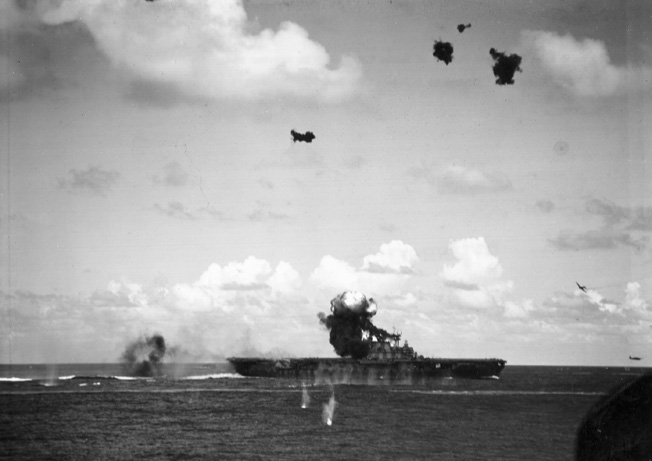A stricken Japanese aircraft crashes into the carrier Hornet during action off the Santa Cruz Islands. The Japanese plane demolished the aircraft carrier's signal bridge. This photo was also taken from the deck of the Pensacola.