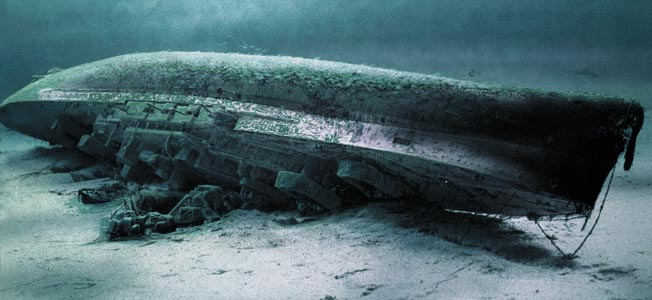 "An artist's computer rendering of the battleship HMS Royal Oak lying on its starboard side in 60 feet of water at Scapa Flow, Scotland. Of 1,234 sailors aboard her, 833 died, including 126 ""boy sailors."""