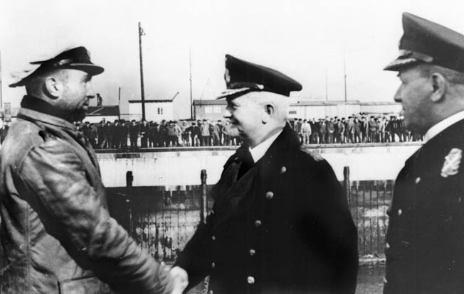 Prien (left) is congratulated by Admiral Karl Dönitz on his successful mission.