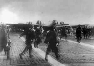 Briefed on their objectives for Pearl Harbor, Japanese pilots rush across the deck of an aircraft carrier on the morning of December 7, 1941.