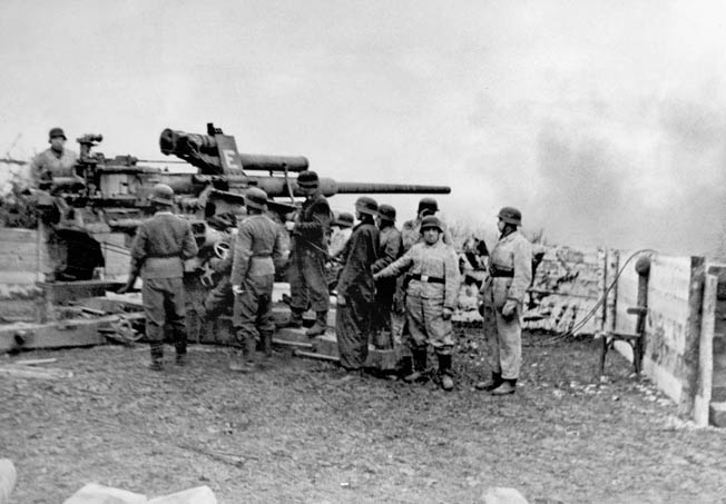 Fighting back, a German 88mm gun fires on Red Army troops approaching the Seelow Heights, a key position 40 miles east of Berlin. Once this position fell, nothing could stop the Soviets from entering the city.