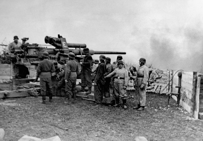 German Brandenburger commando troops firing at Soviet troops on a bridge over the Oder River with an 8.8 cm Flak anti-aircraft cannon.