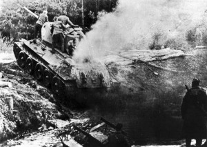 A T-34 Soviet tank crossing the Oder River during the Battle of the Seelow Heights, 18 or 19 April 1945.