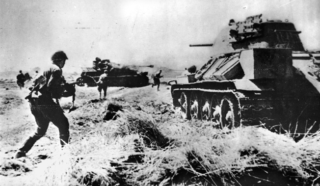 Following their repulse of a German counterattack, Soviet infantrymen and tanks pursue the retreating enemy toward their capital in March 1945. Berlin fell to the Red Army weeks later.