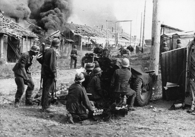 German infantry shell buildings during Operation Störfang. Intense shelling by both sides left the city and countryside scarred by months of brutal combat.